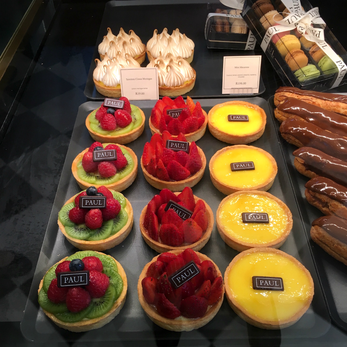 Traditional French patisseries, raspberries and lemon tartlets at PAUL bakery
