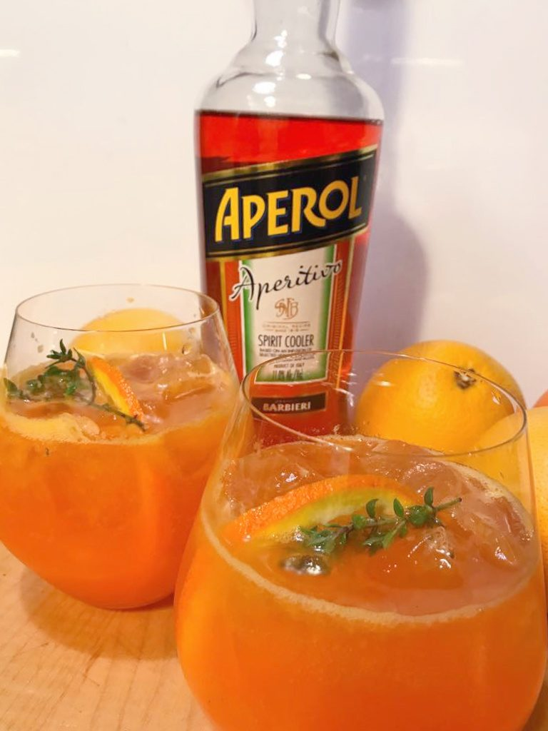 Aperol Spritz Orange and Smoked Thyme Cocktail Recipe Bottles and Glass