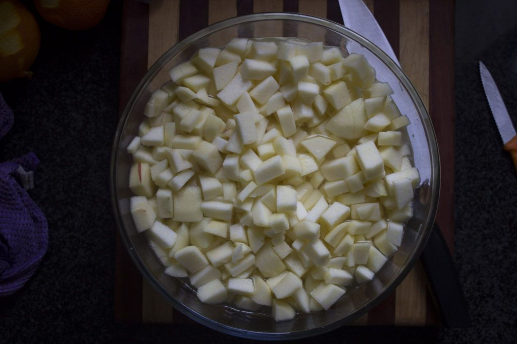 Chopped apples for homemade apple and cardamom jam recipe