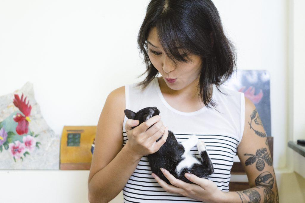 Daton Kim with Maya, her cat